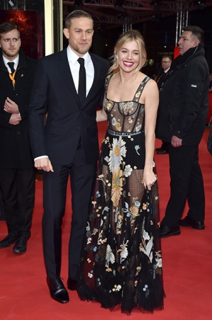 BERLIN, GERMANY - FEBRUARY 14: Actors Charlie Hunnam wearing Prada and Sienna Miller wearing Dior attend the 'The Lost City of Z' premiere during the 67th Berlinale International Film Festival Berlin at Zoo Palast on February 14, 2017 in Berlin, Germany. (Photo by Pascal Le Segretain/Getty Images)