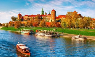 Wawel castle famous landmark in Krakow Poland. Picturesque landscape on coast river Wisla. Autumn sunset with white sky and cloud.